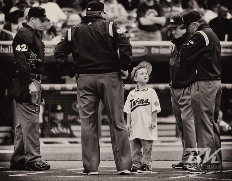A young fan waits at home plate prior to the singing of the national anthem before a game between the Minnesota Twins and the Texas Rangers on Jackie Robinson Day at Target Field in Minneapolis, Minnesota on April 15, 2012.  The Rangers defeated the Twins 4 to 3.  Photo: © Ben Krause 2012