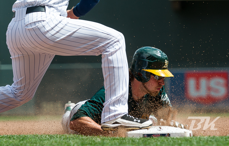 Oakland Athletics right fielder Josh Reddick slides in safely at 3rd base with a triple during a game against the Minnesota Twins on May 28, 2012 at Target Field in Minneapolis, Minnesota.  The Twins defeated the Athletics 5 to 4.  Photo: © Ben Krause 2012
