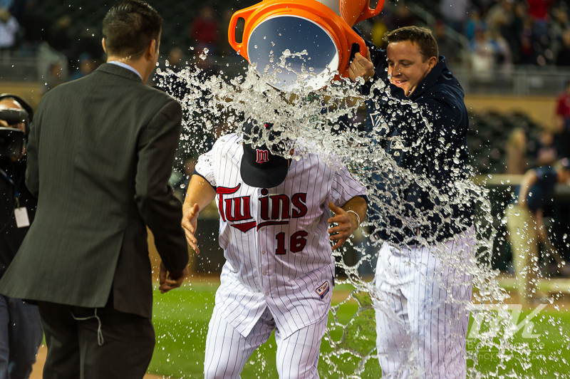 Minnesota Twins right fielder Josh Willingham has Gatorade dumped on him by teammate Matt Capps after Willingham hit a 3-run walk-off home run with 2 outs and down by 2 runs against the Oakland Athletics on May 29, 2012 at Target Field in Minneapolis, Minnesota.  The Twins defeated the Athletics 3 to 2.  Photo: © Ben Krause 2012