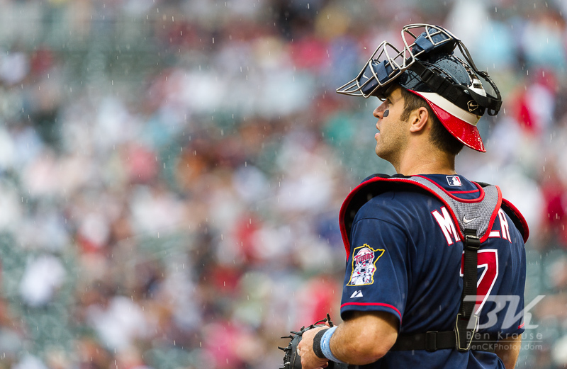 Minnesota Twins catcher Joe Mauer looks on during a game against the Milwaukee Brewers at Target Field in Minneapolis, Minnesota on June 17, 2012.  The Twins defeated the Brewers 5 to 4 in 15 innings.  The game was the longest in Target Field history.  Photo: © Ben Krause 2012