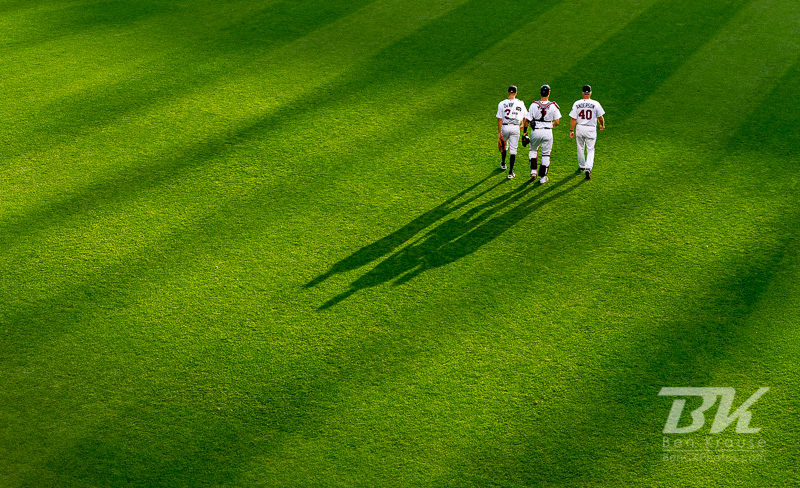 Cole Devries (38), Joe Mauer (7), and Rick Anderson (40)of the Minnesota Twins head for the dugout before a game against the Tampa Bay Rays on August 10, 2012 at Target Field in Minneapolis, Minnesota.  The Rays defeated the Twins 12 to 6.  Photo: © Ben Krause 2012