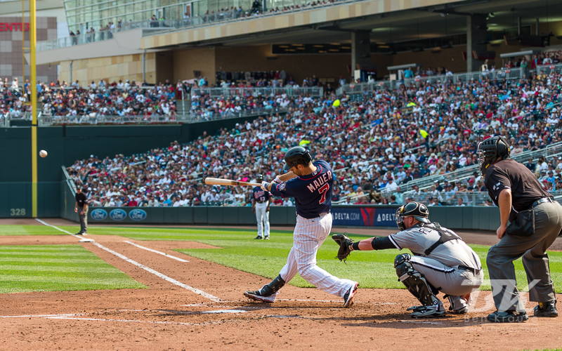 Joe Mauer #7 of the Minnesota Twins connects for a double during a game against the Chicago White Sox on September 16, 2012 at Target Field in Minneapolis, Minnesota.  The White Sox defeated the Twins 9 to 2.  Photo: © Ben Krause 2012