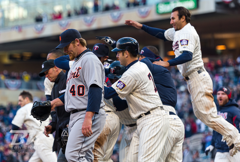 Minnesota Twins players celebrate as Phil Coke #40 of the Detroit Tigers walks off the field after the Twins won in walk-off fashion on April 3, 2013 at Target Field in Minneapolis, Minnesota.  The Twins defeated the Tigers 3 to 2.  Photo: Ben Krause