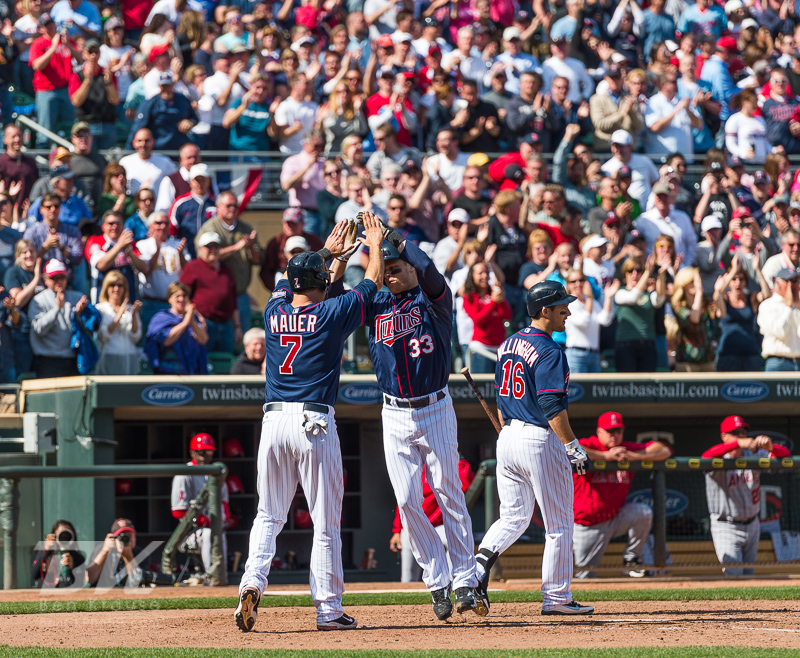Minnesota Twins DH Justin Morneau celebrates with Joe Mauer after hitting a go-ahead home run, his 1st of the year, in the 8th inning against the Los Angeles Angels at Target Field in Minneapolis, MInnesota on April 12, 2012.  The Twins defeated the Angels 10 to 9.