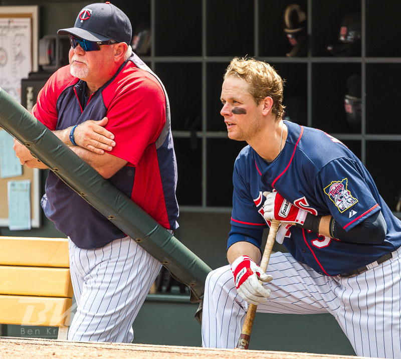 Justin Morneau of the Minnesota Twins looks on from the steps of the dugout with manager Ron Gardenhire during a game against the Milwaukee Brewers on June 16, 2012 at Target Field in Minneapolis, Minnesota.