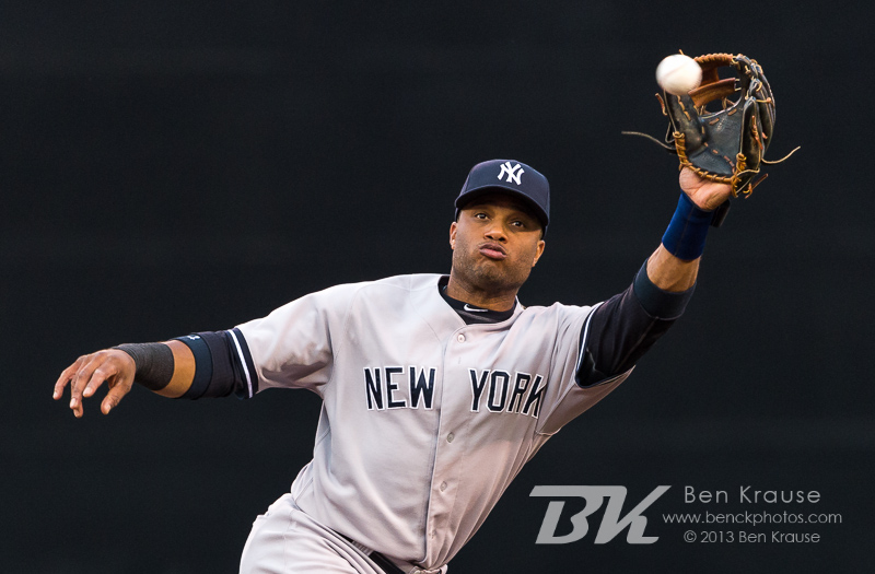 Robinson Cano #24 of the New York Yankees makes a line drive catch against the Minnesota Twins on July 1, 2013 at Target Field in Minneapolis, Minnesota.  The Yankees defeated the Twins 10 to 4.  Photo by Ben Krause