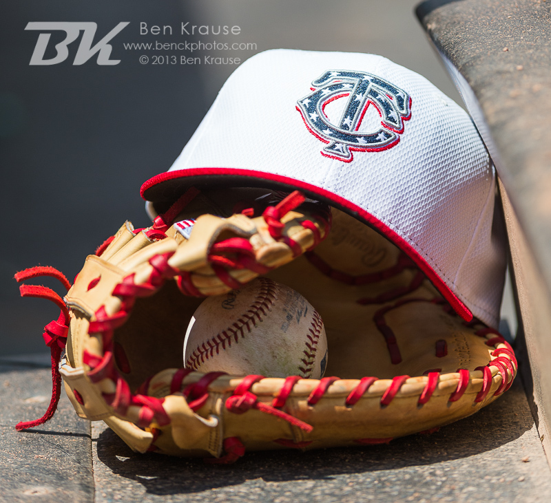 A close up view of the glove and hat of Chris Parmelee #27 of the Minnesota Twins during a game against the New York Yankees on July 4, 2013 at Target Field in Minneapolis, Minnesota.  The Yankees defeated the Twins 9 to 5.  Photo by Ben Krause