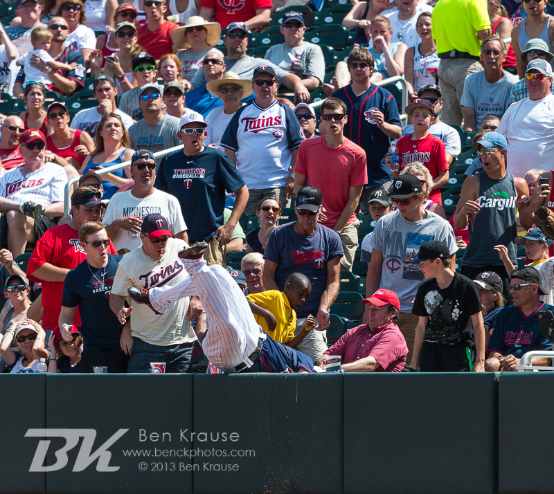 Chris Parmelee #27 of the Minnesota Twins falls into the stands after making a catch against the New York Yankees on July 4, 2013 at Target Field in Minneapolis, Minnesota.  The Yankees defeated the Twins 9 to 5.  Photo by Ben Krause