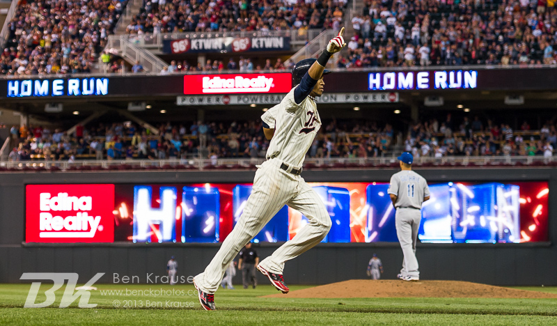 Pedro Florimon #25 of the Minnesota Twins celebrates after hitting a home run against the Kansas City Royals on July 31, 2013 at Target Field in Minneapolis, Minnesota.  The Royals defeated the Twins 4 to 3.  Photo by Ben Krause