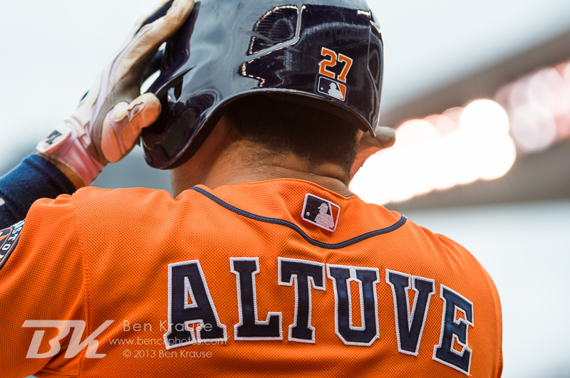 Jose Altuve #27 of the Houston Astros puts on his batting helmet while waiting on deck during a game against the Minnesota Twins on August 4, 2013 at Target Field in Minneapolis, Minnesota.  The Twins defeated the Astros 3 to 2.  Photo by Ben Krause