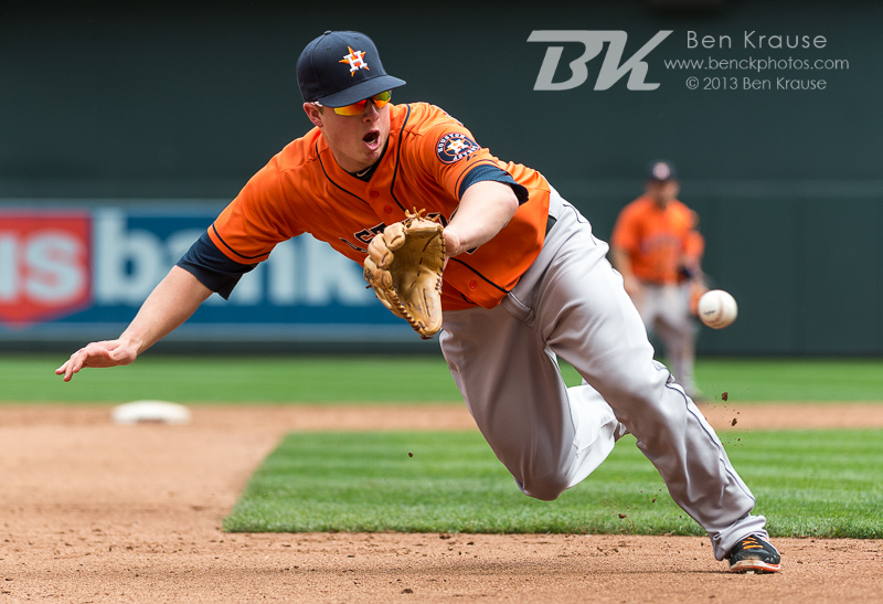 Matt Dominguez #30 of the Houston Astros makes a lunging ground ball stop against the Minnesota Twins on August 4, 2013 at Target Field in Minneapolis, Minnesota.  The Twins defeated the Astros 3 to 2.  Photo by Ben Krause