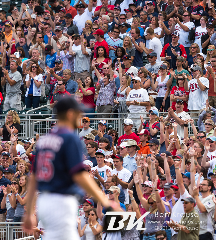 Fans celebrate after Glen Perkins #15 of the Minnesota Twins completes the victory against the Houston Astros on August 4, 2013 at Target Field in Minneapolis, Minnesota.  The Twins defeated the Astros 3 to 2.  Photo by Ben Krause