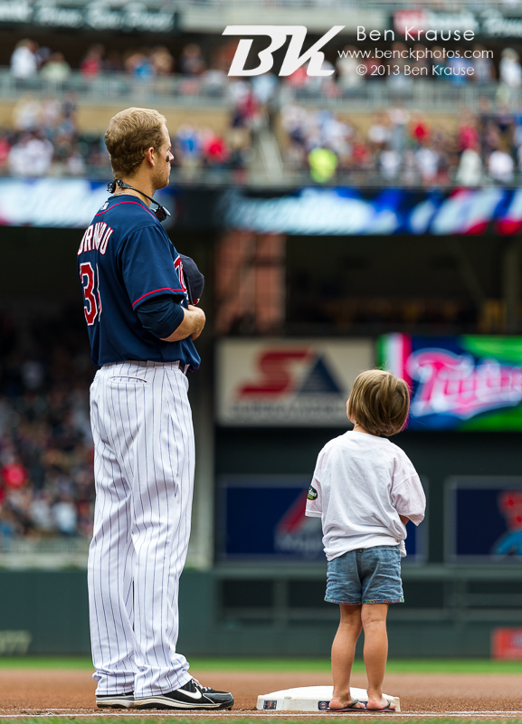 A young fan stares up at Justin Morneau #33 of the Minnesota Twins during the national anthem before a game against the Houston Astros on August 4, 2013 at Target Field in Minneapolis, Minnesota.  The Twins defeated the Astros 3 to 2.  Photo by Ben Krause