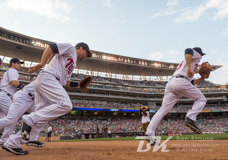 The Minnesota Twins take the field before a game against the Cleveland Indians on August 12, 2013 at Target Field in Minneapolis, Minnesota.  The Twins defeated the Indians 3 to 0.  Photo by Ben Krause