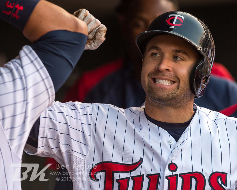 Brian Dozier #2 of the Minnesota Twins is congratulated in the dugout after hitting a home run against the Cleveland Indians on August 12, 2013 at Target Field in Minneapolis, Minnesota.  The Twins defeated the Indians 3 to 0.  Photo by Ben Krause