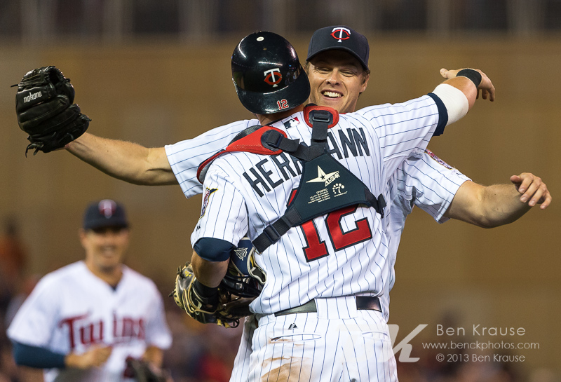 Chris Herrmann #12 and Andrew Albers #63 of the Minnesota Twins celebrate after Albers pitched a complete game 2-hit shutout against the Cleveland Indians in only his 2nd career start on August 12, 2013 at Target Field in Minneapolis, Minnesota.  The Twins defeated the Indians 3 to 0.  Photo by Ben Krause