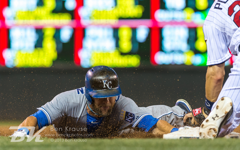 Alex Gordon #4 of the Kansas City Royals is tagged out at 3rd base by Trevor Plouffe #24 of the Minnesota Twins on August 27, 2013 at Target Field in Minneapolis, Minnesota.  The Royals defeated the Twins 6 to 1.  Photo by Ben Krause