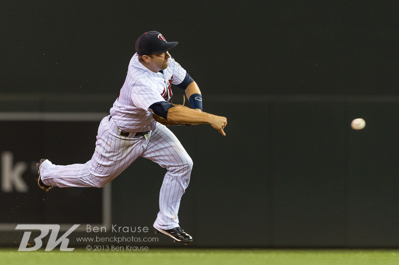 Brian Dozier #2 of the Minnesota Twins makes an off-balance throw to 1st base against the Kansas City Royals on August 27, 2013 at Target Field in Minneapolis, Minnesota.  The Royals defeated the Twins 6 to 1.  Photo by Ben Krause