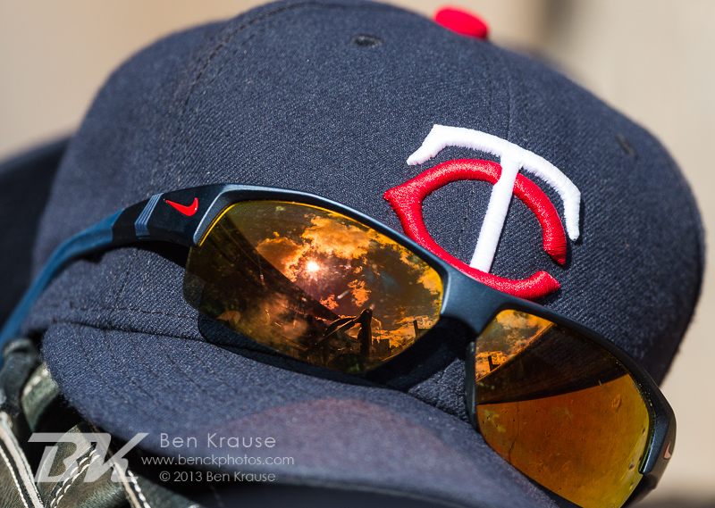 A close up view of a Minnesota Twins hat and sunglasses during a game against the Oakland Athletics on September 12, 2013 at Target Field in Minneapolis, Minnesota.  The Athletics defeated the Twins 8 to 2.  Photo by Ben Krause
