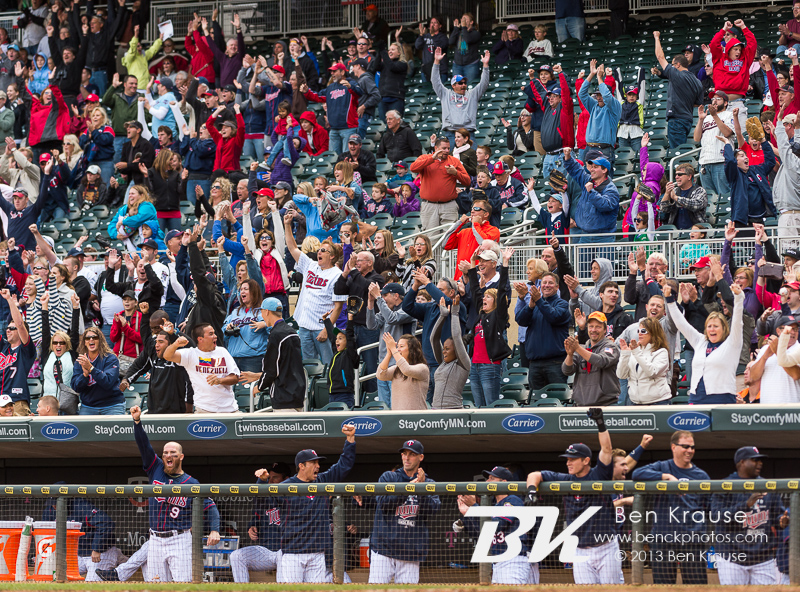 The Minnesota Twins and fans celebrate after Josmil Pinto hit a come-from-behind 3-run home run in the 8th inning against the Tampa Bay Rays on September 15, 2013 at Target Field in Minneapolis, Minnesota.  The Twins defeated the Rays 6 to 4.  Photo by Ben Krause