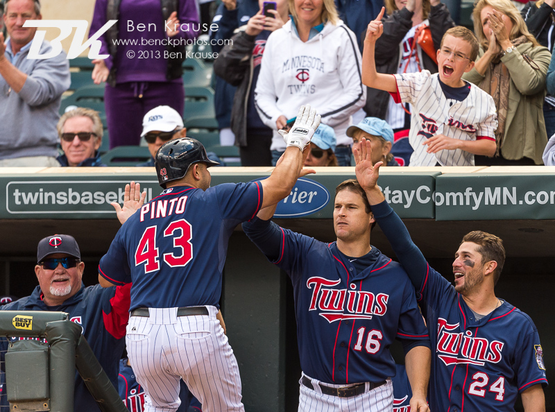 Josmil Pinto #43 of the Minnesota Twins celebrates with his teammates after hitting a come-from-behind 3-run home run in the 8th inning against the Tampa Bay Rays on September 15, 2013 at Target Field in Minneapolis, Minnesota.  The Twins defeated the Rays 6 to 4.  Photo by Ben Krause