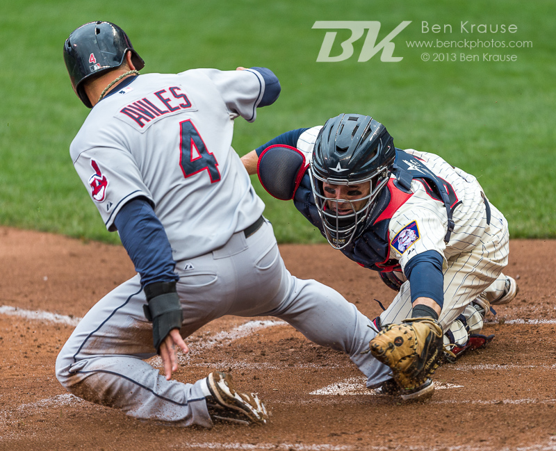 Mike Aviles #4 of the Cleveland Indians is called safe at home plate despite the apparent tag by Eric Fryer #54 of the Minnesota Twins on September 28, 2013 at Target Field in Minneapolis, Minnesota.  The Indians defeated the Twins 5 to 1.  Photo by Ben Krause