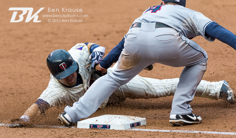 Brian Dozier #2 of the Minnesota Twins is tagged out at 3rd base by Mike Aviles #4 of the Cleveland Indians on September 28, 2013 at Target Field in Minneapolis, Minnesota.  The Indians defeated the Twins 5 to 1.  Photo by Ben Krause